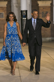 Always on trend, Michelle Obama added a splash of bright blue with this summery print dress.