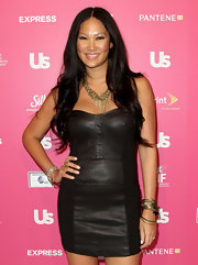 Kimora Lee Simmons brought out her sexy side in a strapless leather dress. She topped her sassy look off with a chain embellished necklace.