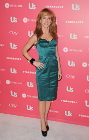 Kathy Griffin complemented her teal satin corset dress with black patent platforms.