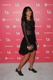 Jessica Szohr added shine to her look with a metallic pewter clutch.
