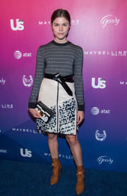 Emily Weiss styled her sweater with an edgy-chic embellished leather skirt, also by Louis Vuitton.