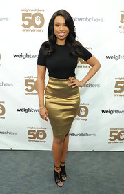 Jennifer Hudson showed off her awesome curves with this short-sleeved black crewneck, which she paired with a gold skirt.
