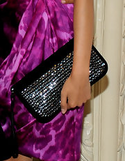 Frieda paired her leopard print dress with a sparkling zip around clutch.