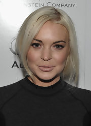 Lindsay Lohan wore a touch of pale pink-beige lipstick at the Weinstein Company and Audi celebrates Award Season.