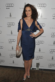 Andie MacDowell wore a navy knit gown with draped sleeves for the Audi Celebration.