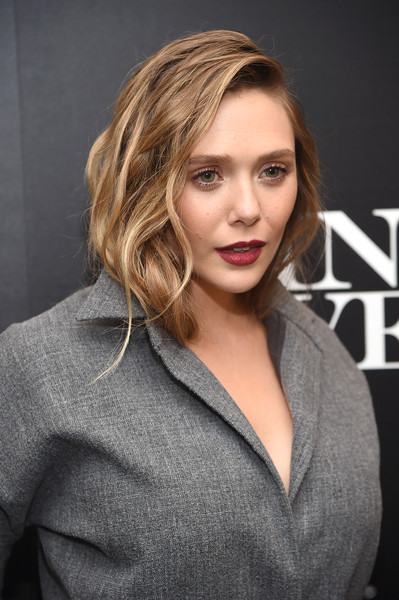 Elizabeth Olsen was sexily coiffed with long waves tucked under her collar during the screening of 'Wind River.'