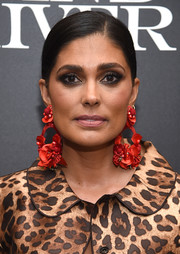Rachel Roy made an ultra-feminine statement with these dangling red flower earrings at the screening of 'Wind River.'
