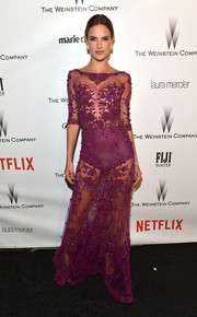 Alessandra Ambrosio donned a sheer, floral-embroidered purple gown by Zuhair Murad for the Weinstein Company and Netflix Golden Globes party. Sheer's becoming her signature (but who's complaining, really?).