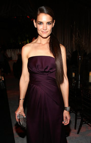 Katie Holmes attended the Weinstein Company Golden Globes after-party carrying a chic silver python clutch by Marchesa.