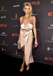 Kelly Rohrbach looked sassy at the Weinstein Company and Netflix Golden Globe party in a dual-textured blush dress with a plunging neckline and an asymmetrical hem.