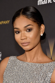 Chanel Iman attended the Weinstein Company and Netflix Golden Globe party wearing her hair in a sleek center-parted chignon.