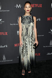 Cara Santana teamed embellished T-strap sandals with a printed maxi dress for the Weinstein Company Golden Globes party.