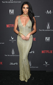 Shay Mitchell put on a curvy display in a skintight olive-green gown by Leah Da Gloria at the Weinstein Company Golden Globes party.