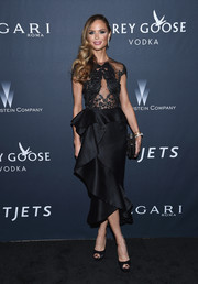 Georgina Chapman exuded feminine elegance, as always, in a sheer-bodice, ruffled LBD by Marchesa at the Weinstein Company pre-Oscar dinner.