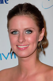 Nicky Hilton wore stunning gold dangle earrings with sparkling embellishments down the center.