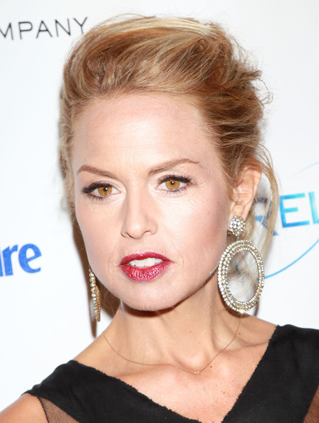 Rachel Zoe is the queen of accessories. The stylist to the stars paired her updo with gorgeous diamond hoop earrings.