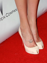 Christa Campbell showed off her peace sign tattoo on the red carpet.