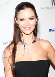 Georgina Chapman spiced up her bare neckline with a bird diamond and sapphire necklace.
