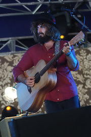 Angus Stone looked tame and stylish in a neat red button-down shirt.