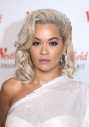 Rita Ora rounded out her look with a pair of oversized diamond hoops.