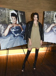 Kendall Jenner attended mom Kris' Haute Living cover celebration wearing a tan tunic dress by Bella Dahl.