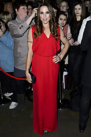 Mel C showed her more girly side with this bright red evening dress at the 2013 Whatsonstage.com Awards.