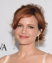 Carla Gugino pinned up her gingersnap locks into a messy updo for the 'White House Down' premiere in NYC.