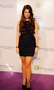 Katherine Schwarzenegger looked demure in a black shift dress with a gathered skirt.