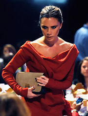 Victoria Beckham carried one of her new luxe two-tone clutches.
