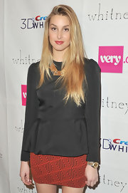 Whitney Port was right on trend in a black long sleeved peplum blouse.
