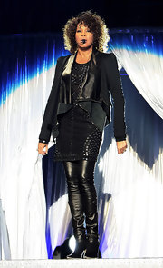 Whitney Houston hit the stage in Milan wearing a draped leather jacket.