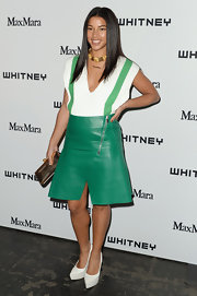Hannah Bronfman gave her leather skirt a fun retro touch with this white and green V-neck sweater.