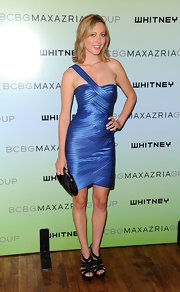 Eva stood out in an electric blue cocktail dress.