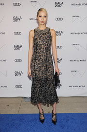 Soo Joo Park finished off her look with black multi-strap pumps, also by Michael Kors.