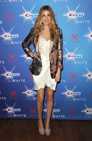 Whitney perfectly accessorized her white satin frock with nude platform pumps complete with mesh and studded detailing.