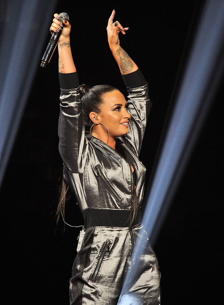 Demi Lovato showed off a huge rose tattoo on her arm while performing at WiLD 94.9's Jingle Ball show.