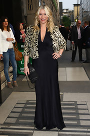 Denise van Outen carried a chain clutch with studded a skull detail for a press night.