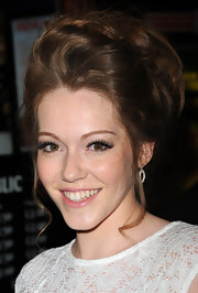 Charlotte Spencer wore her hair in a voluminous updo with soft face-framing strands at the premiere of 'Wild Bill.'