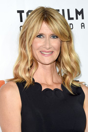 Laura Dern styled her hair with beachy waves and center-parted bangs for the premiere of 'Wild.'