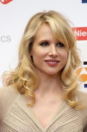 Lucy Punch wore a romatic shoulder-length curly 'do at the 'You Will Meet a Tall Dark Stranger' photocall.