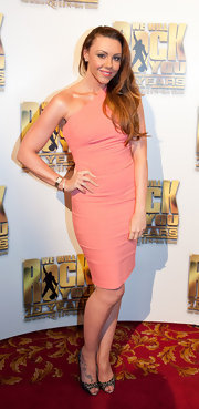 Michelle Heaton looked pretty in a coral one-shoulder dress at the We Will Rock You 10th Anniversary Party.
