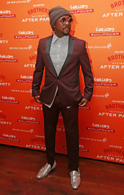 will.i.am chose a burgundy suit with gray lapels for his cool and contemporary look at 'The Ultimate Party.' in New Zealand.