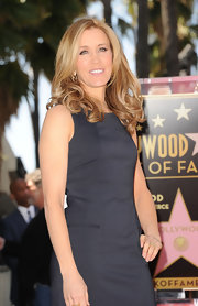 Felicity Huffman wore her blond tresses in long curls while being honored with a star on the Hollywood Walk of Fame.