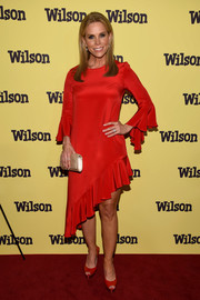 Cheryl Hines looked very girly in a red cocktail dress with an asymmetrical ruffle hem at the New York screening of 'Wilson.'