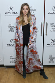 Elizabeth Olsen was boudoir-chic in a floral duster coat by Dries Van Noten at the 'Wind River' party during Sundance.