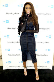 Winnie Harlow attended the ME to WE semiprecious launch looking cool in a strapless denim dress by Cinq á Sept.