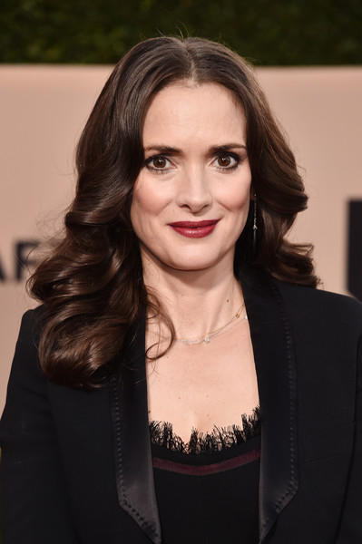 Winona Ryder Long Curls [beauty,hairstyle,fashion model,long hair,black hair,smile,fashion,brown hair,flooring,girl,arrivals,winona ryder,screen actors guild awards,los angeles,california,the shrine auditorium]