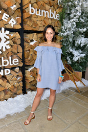 Cara Santana stayed on trend in a blue off-the-shoulder dress with a ruffle neckline when she attended Winter Bumbleland.