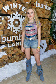 Peyton List teamed her flashy top with basic denim shorts.