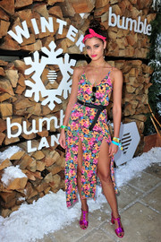 Taylor Hill was feminine and flirty in a double-slit floral sundress while attending Winter Bumbleland.